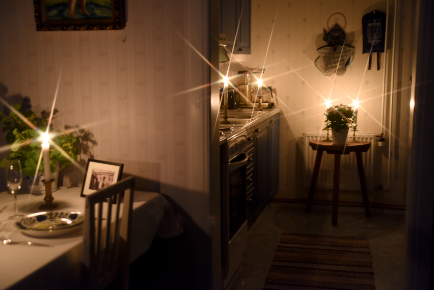 Hotel Krepelin - Rooms - B1 - Living room and kitchen in candle light